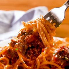 Making your sauce is always better—it's cheaper and so much more flavorful. This one comes together in about 15 minutes and is the perfect accompaniment to the big garlicky meatballs. Get the recipe at Delish.com. #delish #easy #recipe #spaghetti #meatballs #best #stovetop #sauce #italian #groundbeef