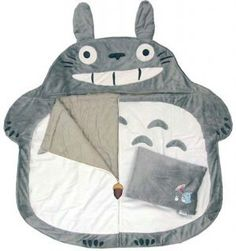 i must have this one day. seriously. it would be a dream come true to sleep on totoro's belly ...