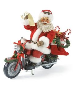 Shiny Red Sled-Santa Claus on a motorcycle with list in hand. Every once in a while Santa leave the red sleigh in the barn and takes his shiny red sled out for a ride. He can't carry as large a gift bag but he get to feel the road under his wheels.