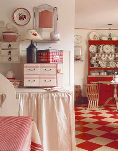 A red checkerboard floor looks great with a few other red accents in the kitchen.