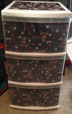 Decorated plastic drawers with Mickey Mouse fabric.