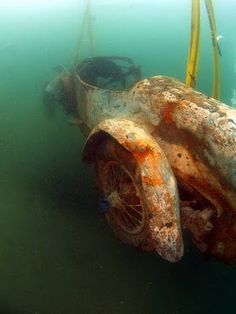 Bugatti fished out of a lake after more than 70 years underwater. http://identicaleye.blogspot.com/2009/12/1925-bugatti-brescia-type-22-roadster.html