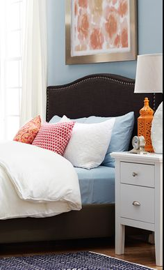 Whether it's in a first apartment or an updated guest suite, this handmade nailhead-trimmed headboard offers the perfect finishing touch for any bedroom. Pair it with crisp sheets for a resort-worthy look, or add bright pillows and a sheepskin throw to create a boho-chic retreat. Update your guest room at jossandmain.com