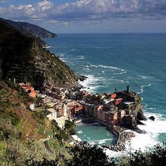 """Cinque Terre, Italy - because I am a romantic at heart <3  The path from Riomaggiore to Manarola is called the Via Dell'Amore  (""""Lovers Walk"""").  At one point people attach padlocks to a fence near a local statue of lovers.  It is said when doing so you are securing your love for ever:)"""
