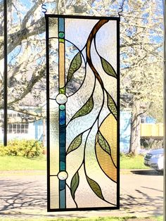 Stained glass window with vine, varied blue and green border and round shapes with amber opalescent glass. - Stained glass window with vine varied blue and green border Modern Stained Glass, Stained Glass Door, Stained Glass Flowers, Stained Glass Designs, Stained Glass Panels, Stained Glass Projects, Stained Glass Patterns, Modern Glass, Leaded Glass