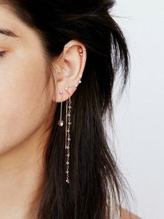 multiple ear piercings, long bohemian dangly earring