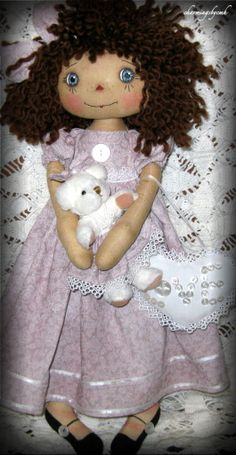 "Annie Doll: Her charm is an Angel Charm engraved with ""Angels Watching Over Me"" ~ I gave her a little white bear dressed similar ~ and a little heart pillow with ""love"" written in buttons. ~charmingsbycmh"