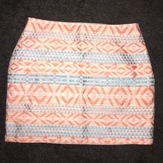 """Aztec mini This is the perfect spring skirt. Fully lined and with an invisible side zipper, it's very high quality for coming from Forever 21. The fabric is a jacquard woven Aztec pattern of corally pink with light blue. It's fully lined. Super cute with just a plain white tee and sandals or dress it up with a blue tank and heels. It's about 15"""" from top to bottom. Never worn. Forever 21 Skirts Mini"""