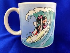 What a fun mug to start my morning with.  Disney's Mickey and  Minnie Mouse  Surfing  made in Japan holds 10 Oz dated  1986