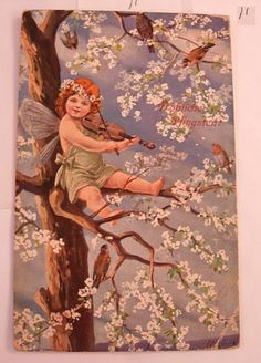 This vintage postcard is in good condition. There is a photo of the front and back so you can see postmarks, cancellations, writing, images and condition. This postcard is of a Fairy in a tree surrounded by birds. The tree is blooming with flowers.
