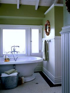 Tall beadboard on walls with trim, topped with tile border.