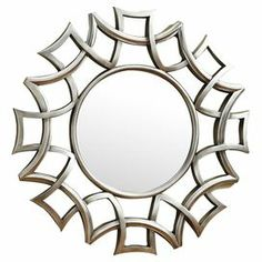 """Bring an eye-catching touch to any room with this chic wall mirror, showcasing a silver finish and interlocking starburst-inspired frame.  Product: Wall mirrorConstruction Material: Metal and mirrored glassColor: Silver frameFeatures: Starburst frameDimensions: Mirror: 20.75"""" Diameter Overall: 40"""" Diameter"""