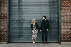 This adorable Milwaukee engagement session is full of super glam outfits, the coolest industrial setting, and our favorite e-sesh trend: smoke bombs!