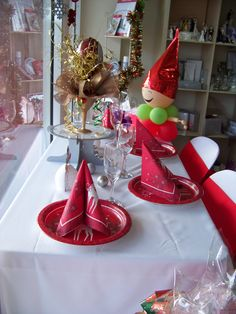 Red, white, gold and silver setting in our font window. #christmas #elf #reindeer #santa www.astylishcelebration.com.au
