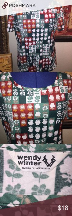 """Vintage Top 100% polyester.  Wendy Winter label. Abstract floral in greens, rust, mustard yellow.  Measurements 22"""" from underarm to underarm. 17"""" across top of shoulders from seam to seam. 15.25"""" length from underarm to bottom of hem. Vintage Tops"""
