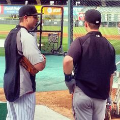 Tulo and Buster Posey chat before a game, a little friendly banter between opponents.