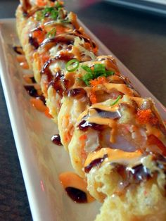 Asuka Roll - Lightly fried with snow crab, crawfish, avocado, masago, cream cheese and special sauce from Asuka Sushi amp; I Love Food, Good Food, Yummy Food, Fried Sushi, Sushi Comida, Seafood Recipes, Cooking Recipes, My Favorite Food, Favorite Recipes