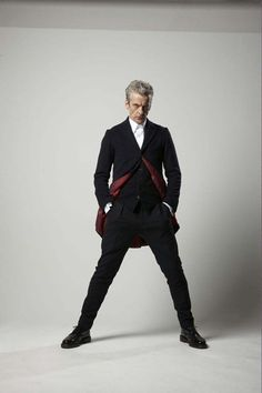 Doctor Who's Peter Capaldi posing in the blue box for Radio Times photoshoot