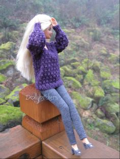 I knitted this awhile back and it is part of my persona; collection.  Gorgeous purple bamboo yarn, fingering weight, knit in a seed stitch pattern into this lovely pull over sweater.  I love this yarn.  So soft and rich looking.