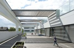 Image 1 of 23 from gallery of Graz University Center for Production + Day Care / Hans Mesnaritsch. Photograph by Angelo Kaunat University Center, Technical University, Shelter Dogs, Light And Shadow, Pet Care, Modern Architecture, Gallery, Building, Outdoor Decor