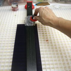 """OK, I thought I would walk you through the making of a fused glass dish. First, I think we'll make a basketweave bowl for my Savannah mold. We'll need 1/2"""" strips of various colors of glass. So we start with scoring some glass. Then I'll snap the strips along the score lines to create my strips."""