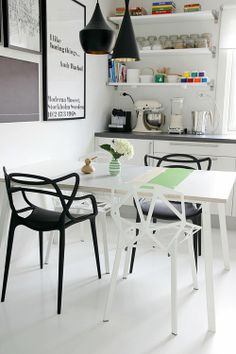 Black and White Pops of Color Kitchen Dining White Floors Open Shelving