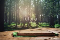 """Download the royalty-free photo """"Empty kitchen board on wooden table on forest background"""" created by kucherav at the lowest price on Fotolia.com. Browse our cheap image bank online to find the perfect stock photo for your marketing projects!"""