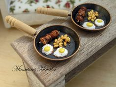 Breakfast pan with two fried eggs, beens and meat skewer on the pan. All details glued to the pan. Hand made. Pan diameter: 2.75cm (1.1 inch) Not for