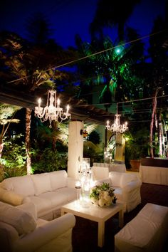 This is just plain amazing. Chandeliers, palm trees, and comfy sofas!