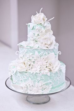 Love! Pale aqua under an all over sugarveil lace and all-white sugar blooms.