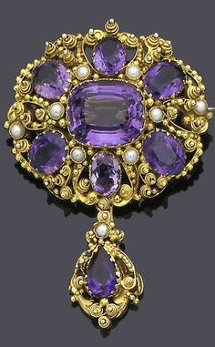 An early 19th century gold cannetille, amethyst and seed pearl brooch, circa 1825 The oval cluster of variously cut amethysts within a border of half-pearls and gold beadwork and bird motifs, terminating in a detachable similarly set drop, length 6.0cm.
