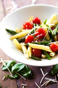 Penne Pasta with Asparagus and Cherry Tomatoes... this recipe is super light and packed with flavor! It is the perfect meal for spring time!