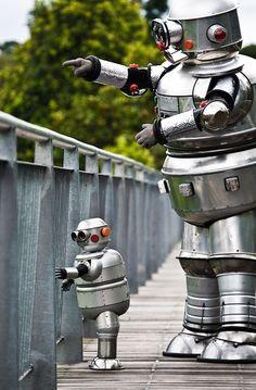 Parent Robot (gender unknown) takes the little one for a walk Vintage Robots, Retro Robot, I Robot, Domo Arigato, Robot Costumes, Cool Robots, Robot Design, Space Crafts, Retro Futurism