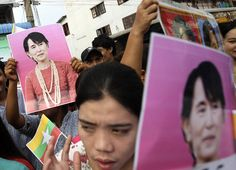 Myanmar workers hold portraits of Myanmar opposition leader Aung San Suu Kyi as they gather to hear her speech in Samut Sakhon, Thailand on Wednesday, May 30, 2012. Kicking off her first trip abroad in nearly a quarter-century, Suu Kyi offered encouragement Wednesday to impoverished migrants whose flight to neighboring Thailand is emblematic of the devastation wrought on her homeland by decades of misrule. SAKCHAI LALIT - AP
