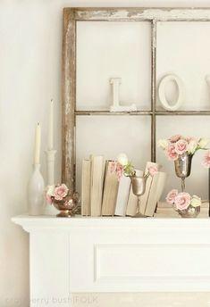white neutral mantle shelf decor  vintage window frame, books, buds