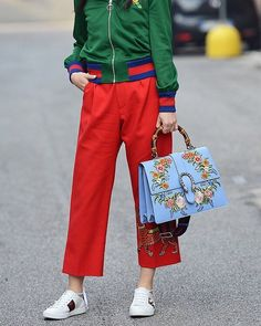 """An ankle length pant made in structured wool-silk crepe. Hibiscus red crepe wool-silk. Ankle length. Fit: fitted on the hips then flares out, sits on the waist, no stretch. Wool/silk. Made in Italy. Gucci floral-embroidered leather satchel bag with signature web trim. Golden hardware. Flat top handle, 4.8"""" drop. Removable, adjustable shoulder strap, 16.5"""" drop. Flap top with curb chain and buckle details. Interior, microfiber lining; one zip and two slip pockets. 8.5""""H x 12.5""""W x 4.5""""D…"""