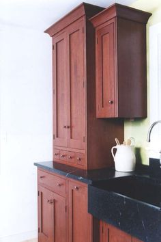 Like the color of these cabinets, and the small drawers.
