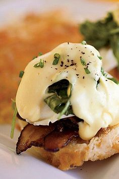 In her version of eggs Benedict, Tara Lazar swaps in applewood-smoked bacon for the usual Canadian bacon, because she prefers its rich flavor and crisp texture. #breakfastrecipes #brunchrecipes #breakfastideas #brunchideas Best Brunch Recipes, Easy Holiday Recipes, Egg Recipes For Breakfast, Favorite Recipes, Breakfast Ideas, Breakfast Sandwiches, Breakfast Club, Breakfast Dishes, Gourmet Breakfast