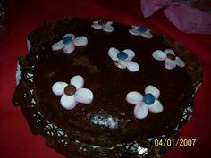 Tarta de chocolate con flores de nube