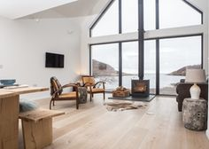 The Net Store   United kingdom Highland Scotland. Surrounded by wildlife and water, this ultra-modern house has huge windows, white walls and designer furnishings. Blissfully remote