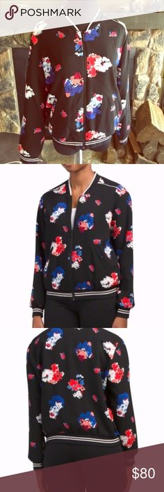 BNWT Vince Camuto Traveling Blooms Bomber Jacket Absolutely adorable bomber jacket by Vince Camuto! Floral print, ribbed trim with front pockets. Lightweight jacket, hits at waist. Fits true to size. Bust and length measurements pictured. A sporty bomber jacket with a feminine update. Textured crepe fabrication with an allover floral print. Striped ribbed knit. Ribbed baseball collar. Full-zip closure. Long sleeves with ribbed cuffs. Slash hand pockets. Ribbed hemline. Lined. 100% polyester…