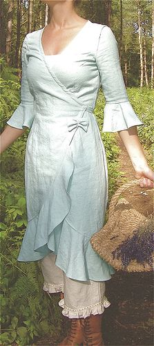 aqua wrap dress, pantaloons with ruffles, and lace-up boots. I would wear this.