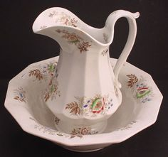 T.F & Co. Ironstone wash bowl and pitcher in the floral pattern