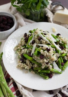 This beautiful Brown Rice Spring Salad with Asparagus and Dried Cranberries is vegan, healthy, gluten free, and perfect for all of your lunching and brunching needs!  - notjustbaked.com