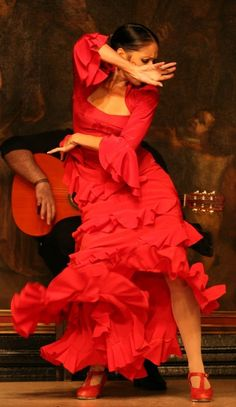 I love Flamenco...the passion, the fire, the red, frilly dresses. The attitude.