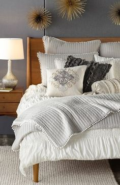 Guest Rm: w/ curly maple bureau + bedside table, faux bois pole lamp, silver genie lamp, fluffy lambskin toss pillows, cream rug.