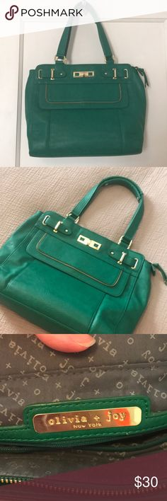 Emerald Green Genuine Leather Tote Bag Olivia & Joy genuine leather tote bag. Emerald green with gold details. One exterior pocket. Cotton lining. Three interior pockets and one interior zip pocket. Slight wear on gold finishing but not really noticeable. Olivia + Joy Bags Totes