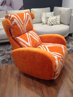 Orange fabrics nicely set off our newest electric recliner designer chair.  The plain is Pascal and patterned is Rombo.