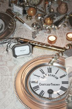 clock face copy between silver chargers and clear plates. ciao! newport beach: a peek at my New Year's table