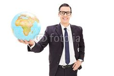 Happy young businessman holding a globe
